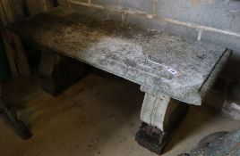 A reconstituted stone garden bench seat, width 106cm