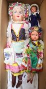 Two composition dolls, 1936, height 50cm and 32cm, a clockwork celluloid sailor doll, height 17cm