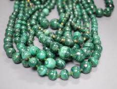 Ten assorted single strand malachite bead necklaces, two with gilt metal spacers, largest approx.