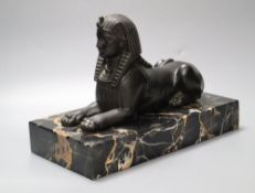 A bronzed spelter and marble sphinx, on marble plinth, height 32cm