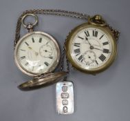 "A brass ""Railway Timekeeper"" pocket watch, a 935 pocket watch and a silver ingot pendant."