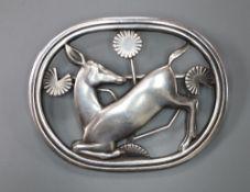A Georg Jensen sterling 'kneeling deer' oval brooch, no. 256, 42mm, 12.2 grams.CONDITION: Overall