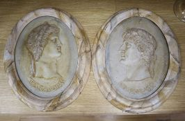 A pair of painted resin Claudius plaques, height 38cm
