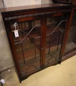 A reproduction mahogany bookcase, with astragal glazed doors, width 81cm, depth 25cm, height 102cm