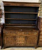A George III oak dresser, width 155cm, depth 46cm, height 205cm