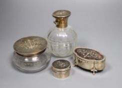 Three various tortoiseshell and silver pique-mounted glass toilet jars and a small silver circular