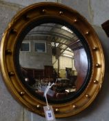 A Regency style convex wall mirror, 42cm diameter