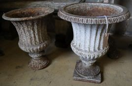 A pair of Victorian cast iron campana garden urns (one lacking plinth foot and rim), taller 49cm