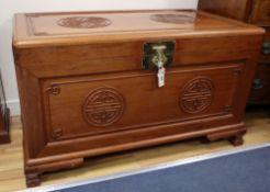 A Chinese hardwood 'shou medallion' chest, width 101cm, depth 55cm, height 59cm