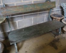 A Victorian cast iron 'serpents' garden bench with painted wood back and seat, width 127cm, height