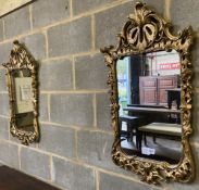 A pair of carved giltwood wall mirrors, with pierced frames, width 48cm, height 85cm