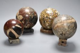 Four marble balls on stands
