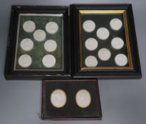A collection of intaglio relief portrait plaques in a tray and a pair of framed sets