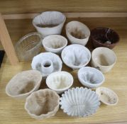 A collection of ceramic and toleware jelly moulds