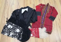 A black shawl with white embroidery, a smaller embroidered shawl, a kimono and a claret