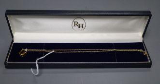 A citrine and diamond rectangular pendant on 9ct gold fine chain, chain 38mm, pendant 15mm, gross