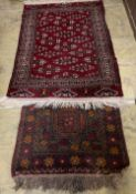 A Bokhara rug and a Turkish geometric rug, larger 150 x 100cm