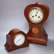 An Edwardian balloon clock, height 33cm and anotherCONDITION: Larger clock badly split at top, above