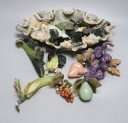 A Chinese soapstone 'lotus' dish containing hardstone models of fruit and a hardstone model of