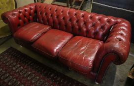 A buttoned red leather Chesterfield settee, width 194cm, depth 82cm, height 72cm