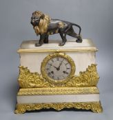 A French gilt and silvered mantel clock, with associated lion surmount, height 40cm