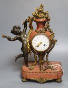 A 19th century French ormolu mounted rouge marble mantel clock, cast with putti, height 36cm