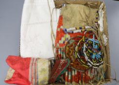 A native North American North Plains beaded leather pouch, a pair of Chinese embroidered shoes,