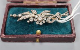 A Victorian yellow and white metal, diamond set floral spray brooch, 58mm, gross 7.5 grams.