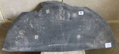 A slate panel decorated with traces of a painted armorial, c.1850, width 80cm height 34cm