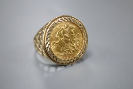 A George V 1925 gold half sovereign, now in 9ct gold ring mount, size V, gross 7.9 grams.