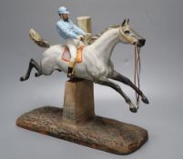 A cast coloured bisque porcelain horse and jockey group, height 26cmCONDITION: Horse tail appears to