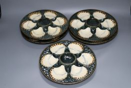 A set of five Longchamp maiolica oyster dishes, 24cm