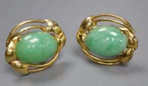 A pair of 585 yellow metal and oval cabochon jade set cufflinks, gross 12.2 grams, cabochon size