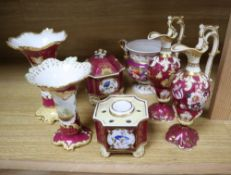 A group of English porcelain ruby ground vessels, c. 1825-45, including two inkwells and one