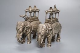 A pair of cast silver plated models of ceremonial elephants, 11cm high