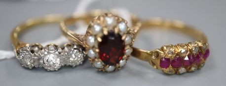 Two 18ct and gem set rings including a three stone diamond ring and a ruby and diamond ring, gross