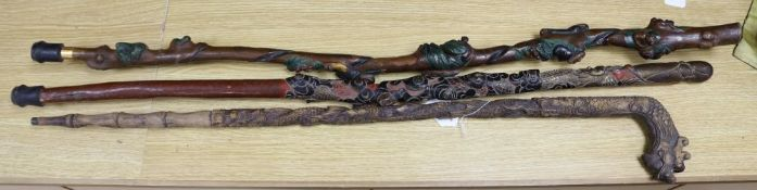 Three Chinese carved wood walking sticks, largest 108cm