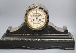 A large Victorian black slate mantel clock, with French bell-striking movement, 56cm wide