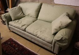 A modern Victorian-style two-seater settee, upholstered in patterned green fabric, width 220cm depth