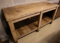 A Victorian beech and pine two tier kitchen table, width 183cm depth 65cm height 87cm