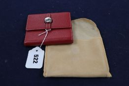 A Hermes, Paris red leather purse and cloth cover