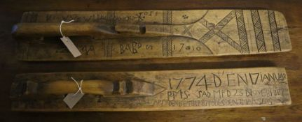 An 18th century Swedish mangle board and another, longest 84cm