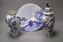A delftware vase, 22cm, delft vase and a painted wall plate, 26cmCONDITION: 18th century vase -