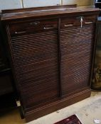 A walnut double tambour filing cabinet, circa 1935, fitted sliding trays, width 90cm, depth 42cm,