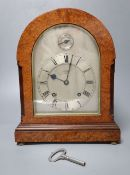 An Edwardian eight day birds eye maple cased mantel clock, with chiming movement, retailed by