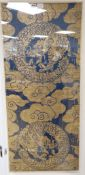 A Chinese gold thread embroidered panel, depicting celestial dragons amongst stylised clouds