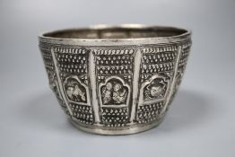 An early 19th century Burmese white metal, embossed with figures, fish, animals and crustaceans,