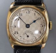 A gentleman's early 1930's 9ct gold manual wind wrist watch, with checkered dial, on later strap.