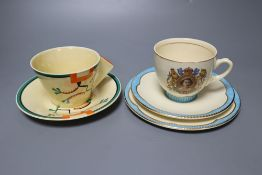 A Clarice Cliff Ravel pattern tea cup and saucer and a Queen Elizabeth II coronation trio,