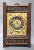 A French Aesthetic style oak mantel clock with enamelled ceramic dial, gong striking movement,